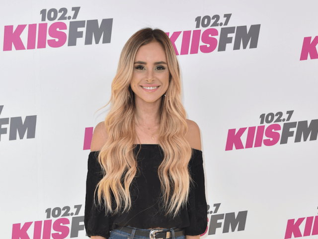 Amanda Stanton smiles and poses for photos at an event.