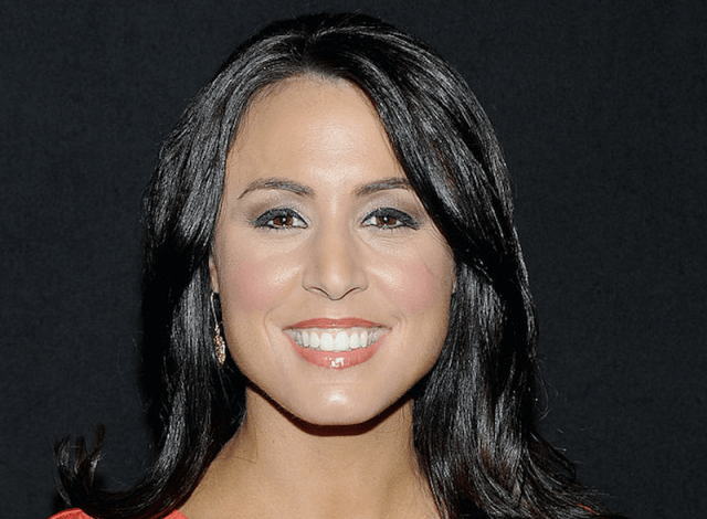 Andrea Tantaros smiles brightly while posing for photographers.