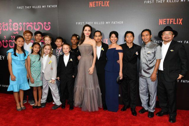 Angelina Jolie poses with her family on the red carpet.
