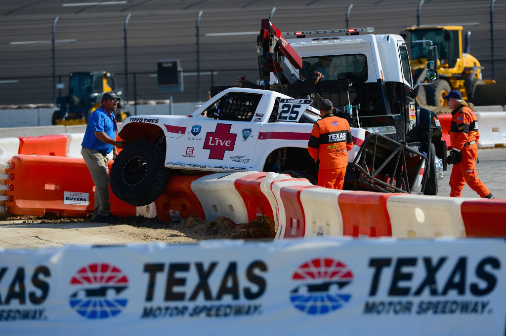 Arie Luyendyk Jr. is helped after crashing