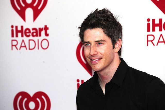 Arie Luyendyk Jr. smiling and posing for photos at the iHeartRadio festival.