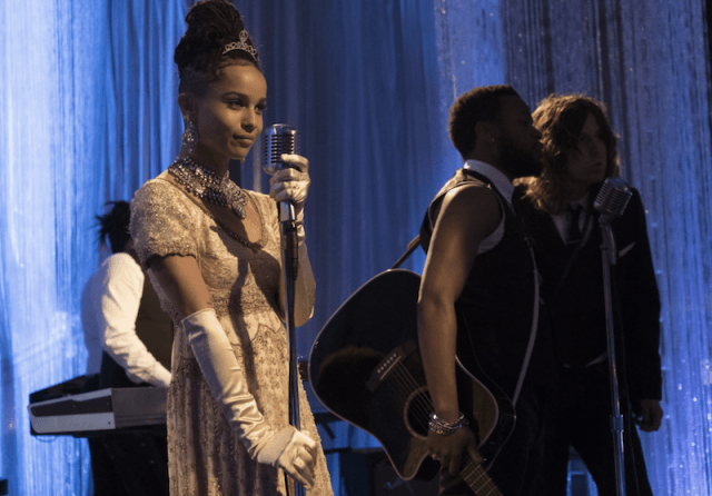 Zoë Kravitz stands in front of a microphone on 'Big Little Lies'.