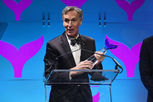 Bill Nye holds a trophy at the Shorty Awards.