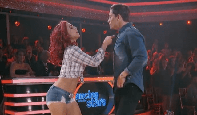 Sharna Burgess and Bonner Bolton dancing together on the dance floor.