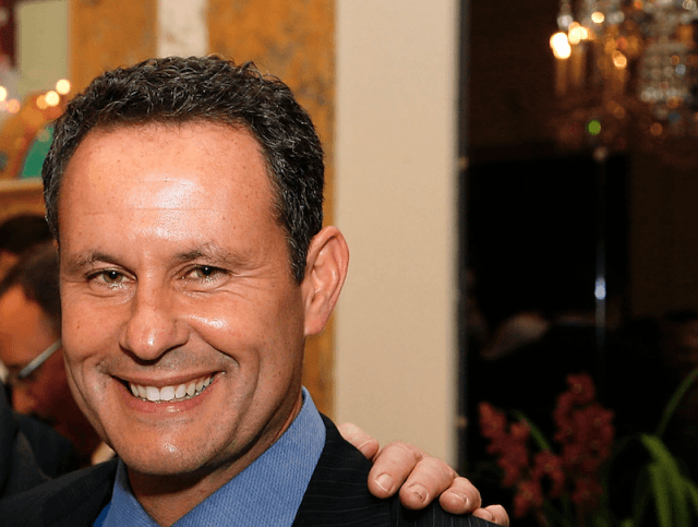 Brian Kilmeade poses for photos at a formal event.