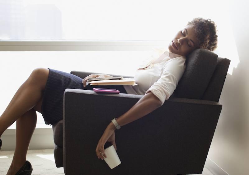 Businesswoman asleep in her chair