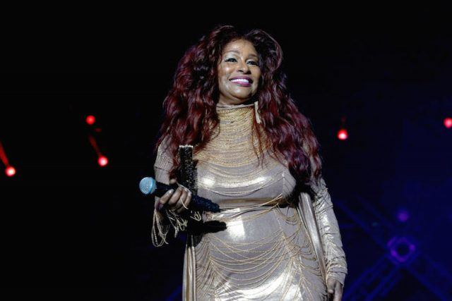Chaka Khan holding a microphone while on stage.