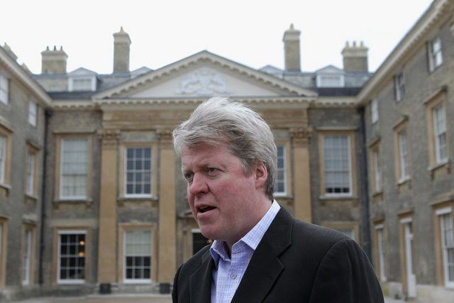 Charles Spencer standing in front of the Althorp House.