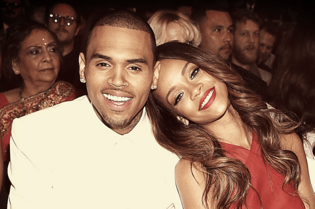 Chris Brown and Rihanna smiling together.