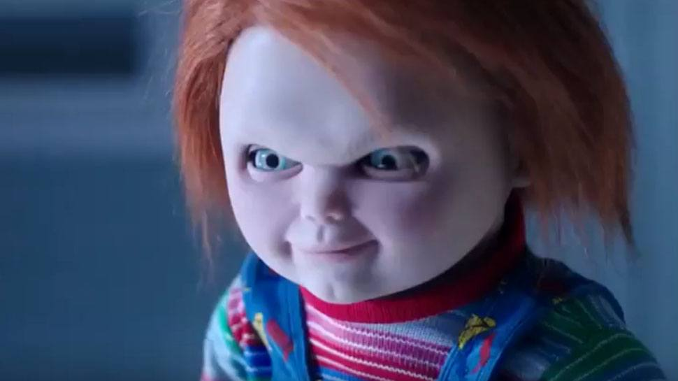 Chucky stares ahead with an evil smile