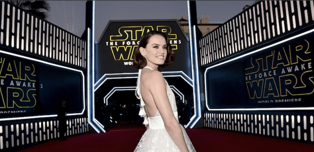 Daisy Ridley at the Star Wars Premiere posing in a white dress.
