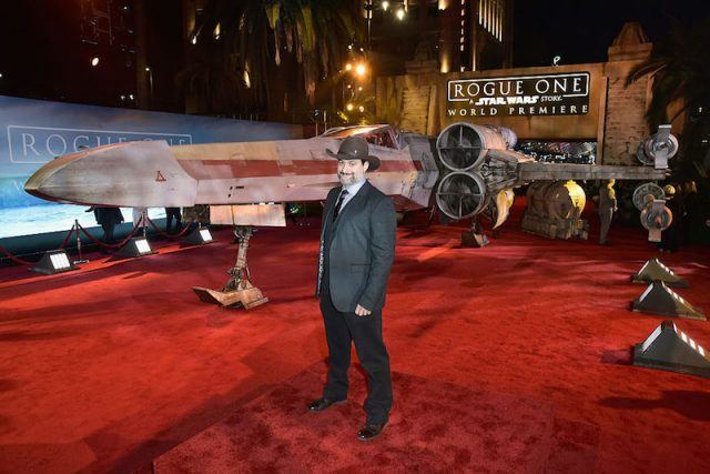 Dave Filoni standing with the movie set pieces.