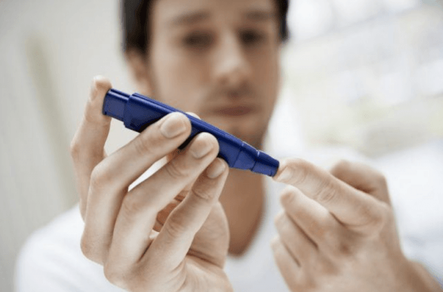Man with diabetes checking blood sugar