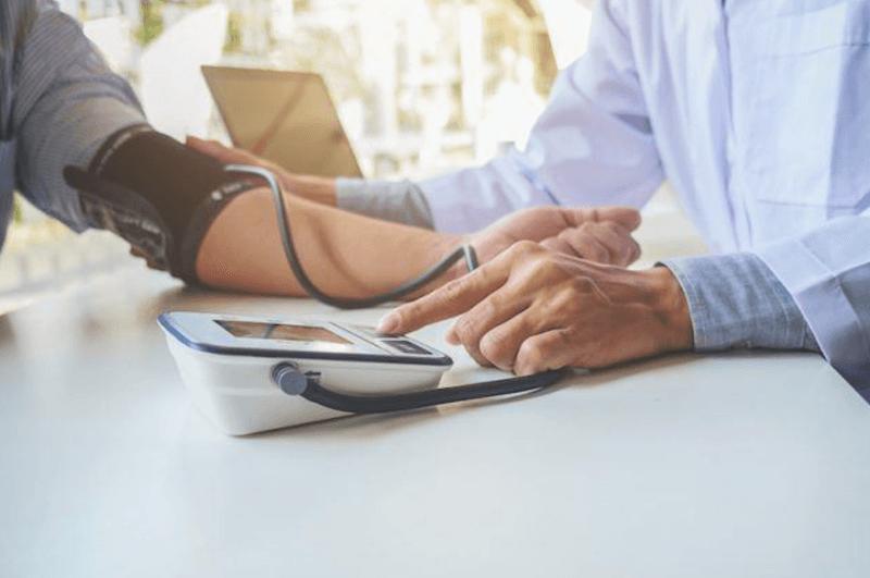 doctor taking blood pressure