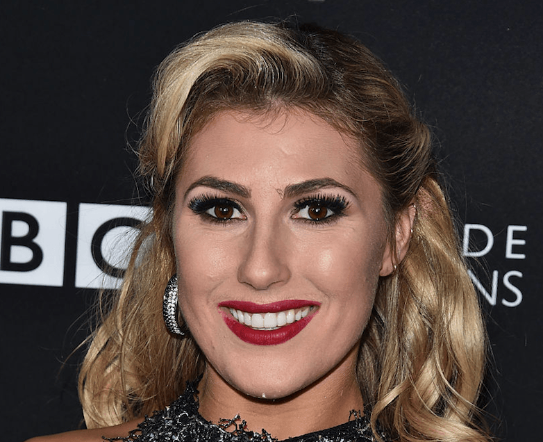 Emma Slater smiles at the camera.