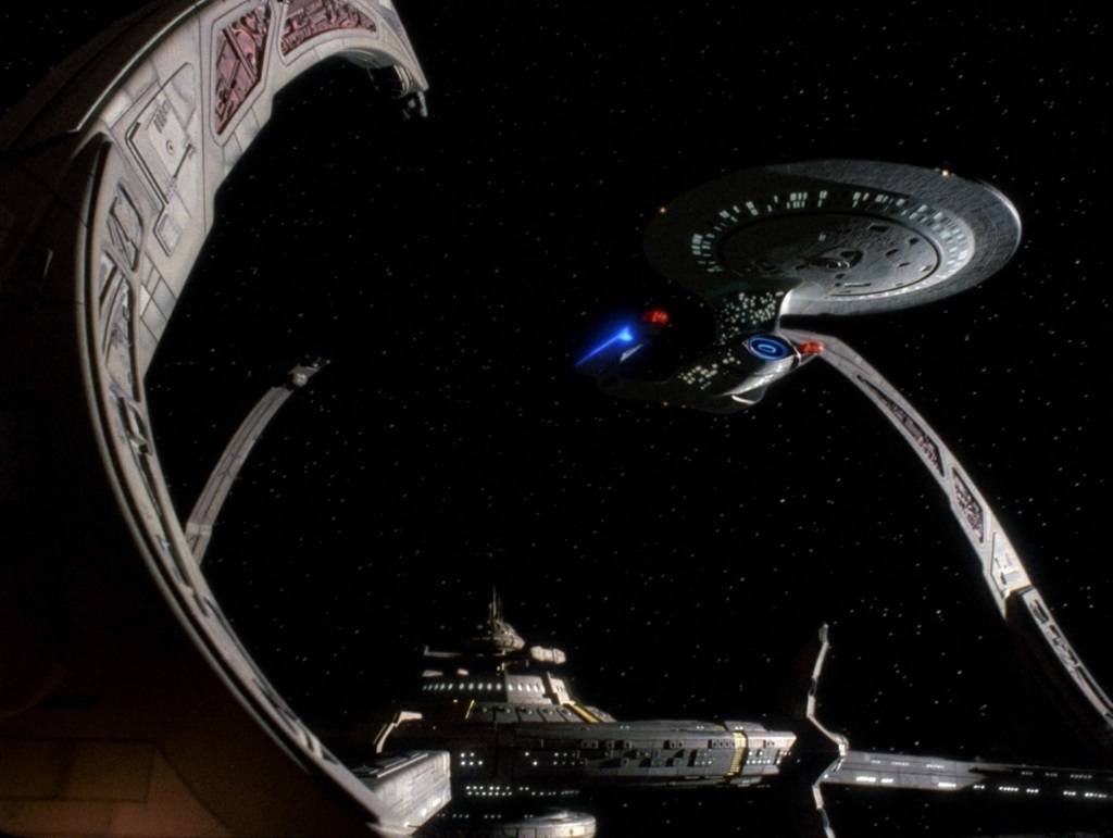 The Enterprise docked at the Deep Space Nine station.