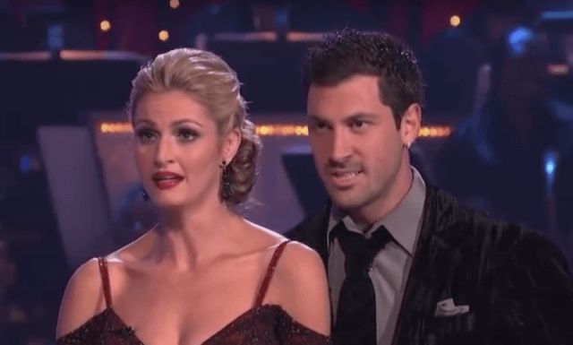 Maksim Chmerkovskiy and Erin Andrews stand together after their routine as they listen to the judges score their dance.
