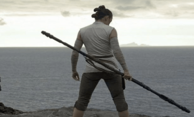 Ren holds her sword while overlooking the sea