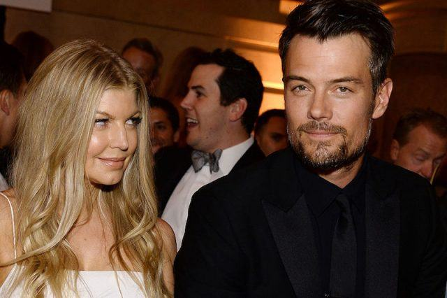 Fergie looks over at her ex-husband as they stand together at a formal event.