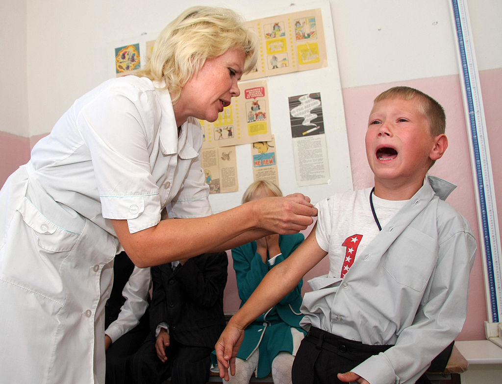 Boy cries as he gets flu vaccination