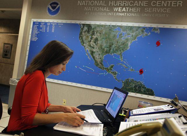 Meteorologist Jessica Schauer works on tracking Hurricane Earl at the National Hurricane Center on August 30, 2010 in Miami, Florida