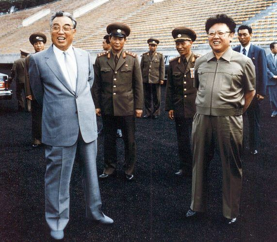 photo taken in 1992 shows North Korean leader Kim Jong-Il (R) and then-leader, Jong-il's father, Kim Il-Sung (L) inspecting a soccer ground in Pyongyang. Kim Jong-Il was named General Secretary of the ruling Workers Party 08 October, one of two top posts left vacant since the death of the elder Kim in 1994.