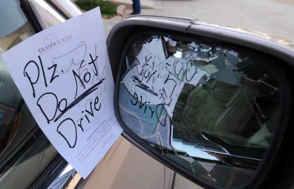 a note on a broken car mirror
