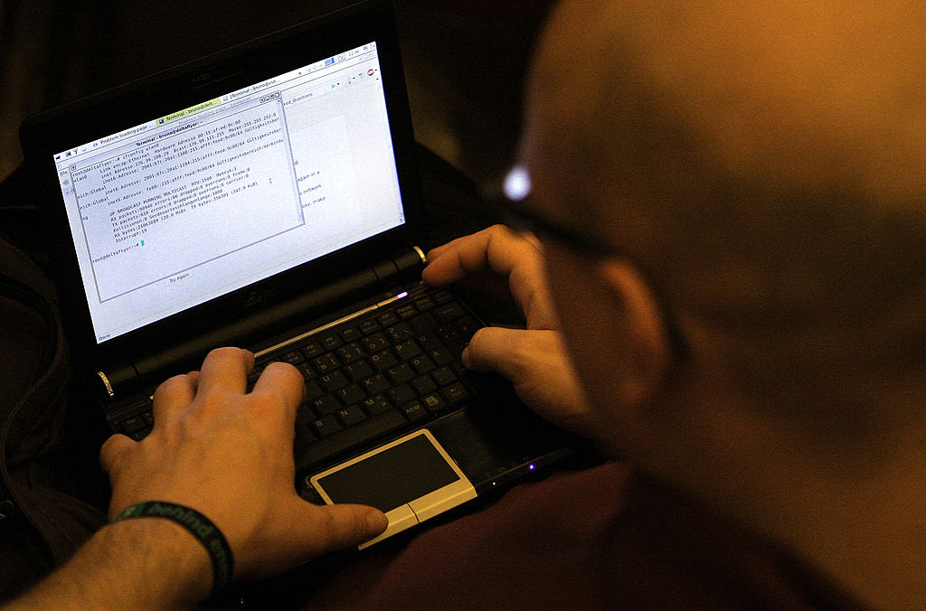 a coder at a computer