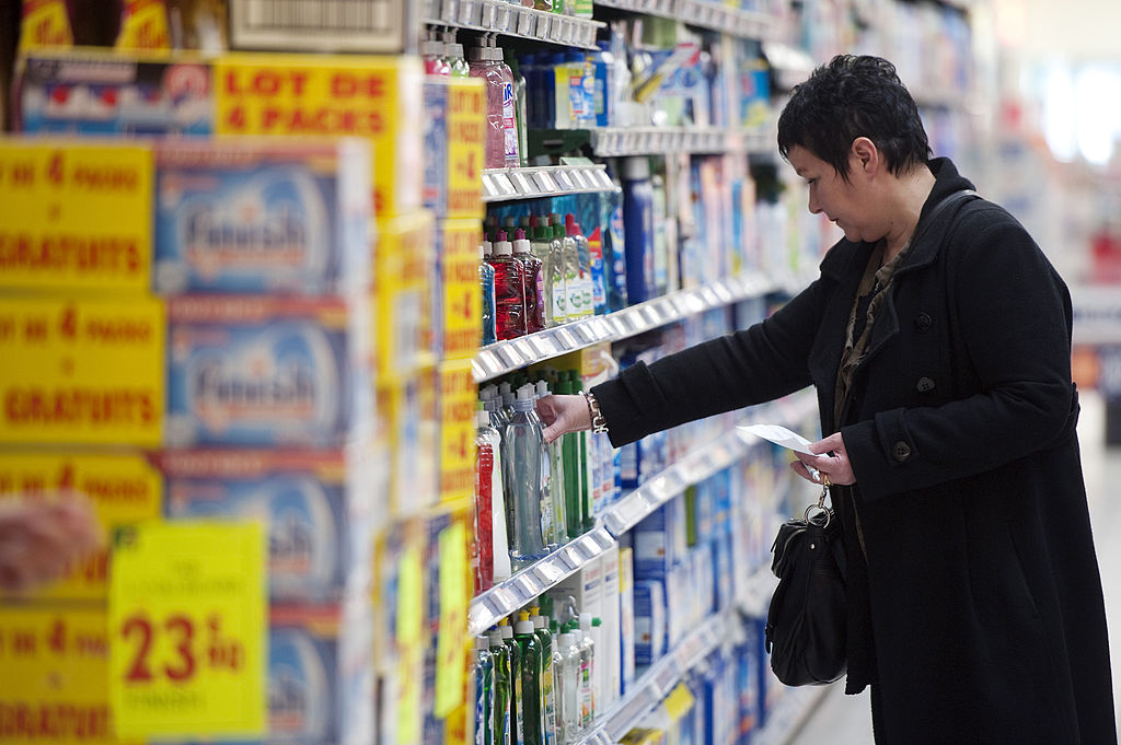 woman shops for cleaning supplies