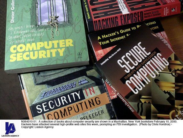 cybersecurity book pile