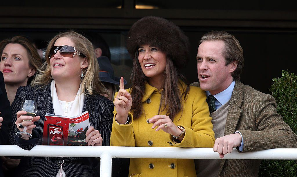 Pippa Middleton (C) and Tom Kingston (R) watch the races at Cheltenham Racecourse at the Cheltenham Festival 2013 on March 14, 2013 in Cheltenham, England.