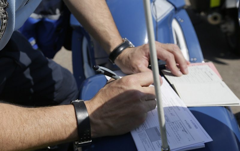 officer writing ticket