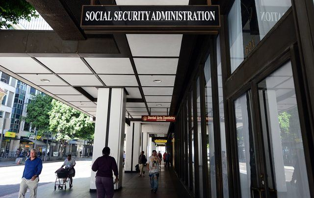 Pedestrians walk past the Social Security Administration office in downtown Los Angeles