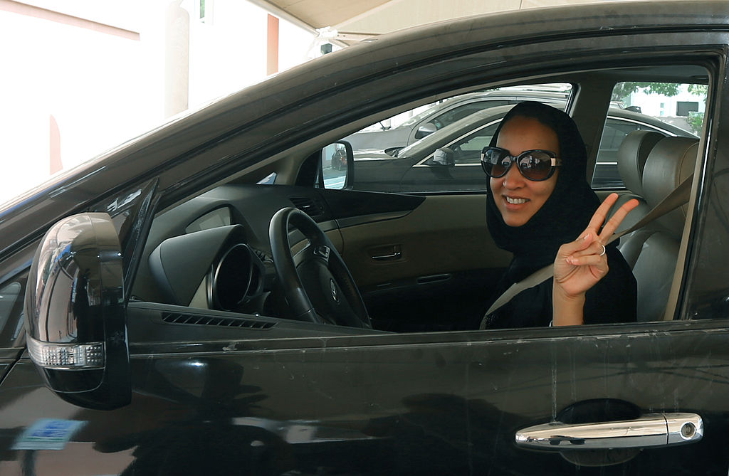 woman driver with peace sign in Saudi Arabia