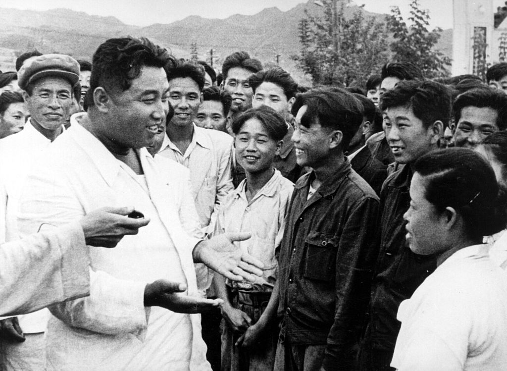 1967: North Korean dictator, Kim Il Sung, chats with workers on an unofficial visit to the Hichun Machine Plant.