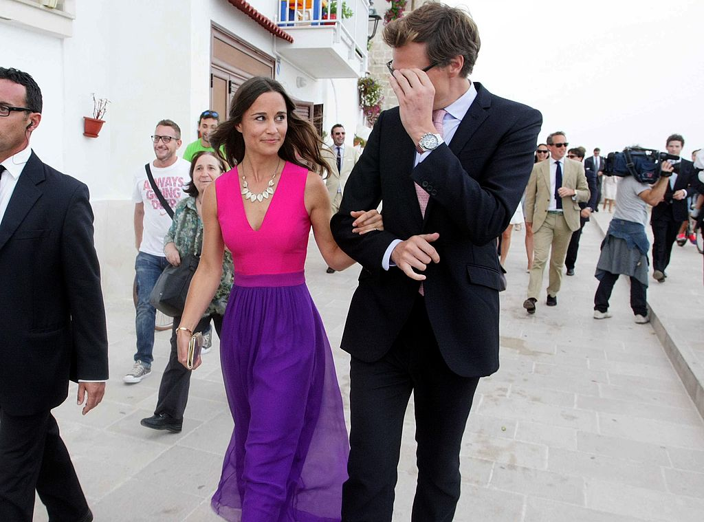 Pippa Middleton (L), leaves on September 19, 2014 with Nico Jackson the wedding ceremony of her friends, Charlie Gilkes and Anneke von Trotha Taylor, at the Carlo V Castle in Monopoli.