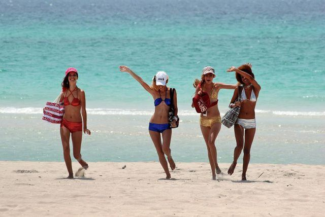 Models dancing on the beach