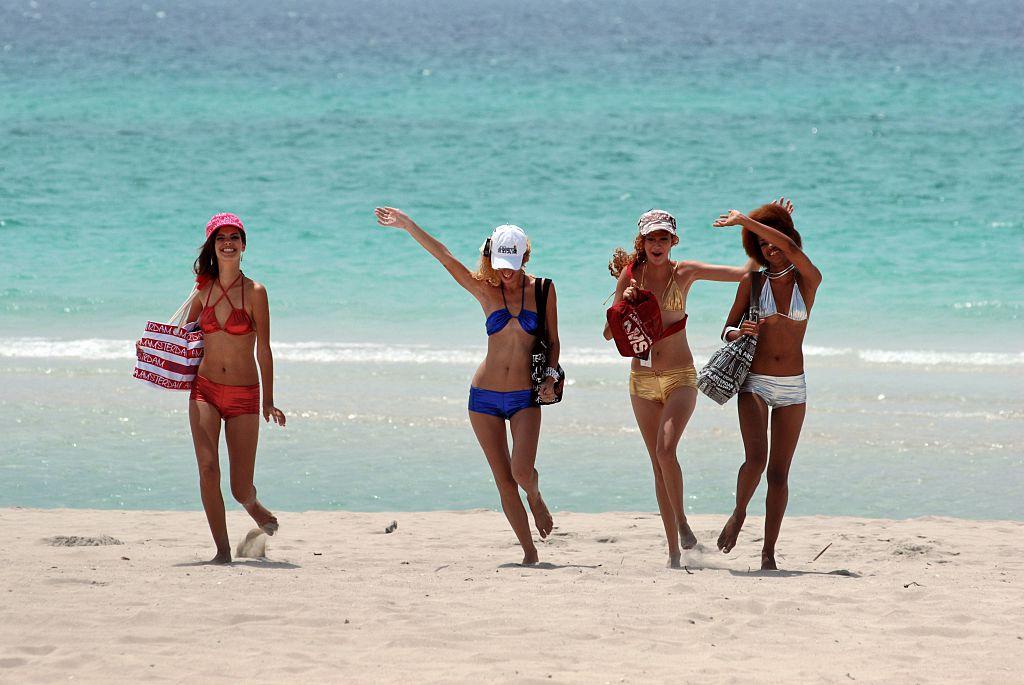 women in swimsuits on beach