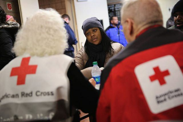 Aisha Watts applies for assistance at an American Red Cross disaster relief center