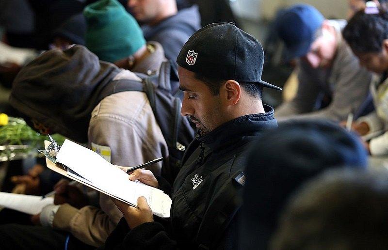 man fills out paperwork