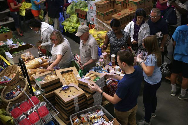Low-income residents select fresh bread and produce at the Community Food Bank of New Jersey