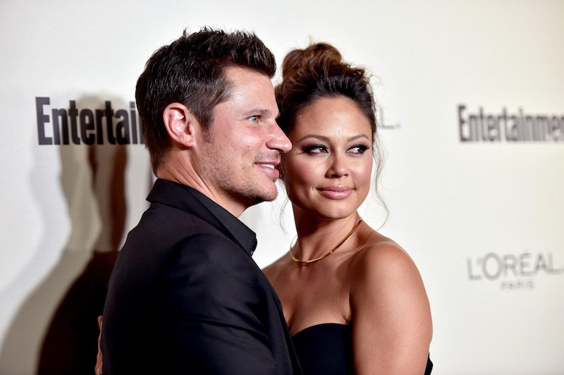 Nick and Vanessa Lachey pose at an event