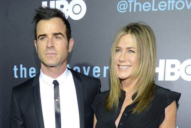 Justin Theroux and Jennifer Aniston pose together on a red carpet.