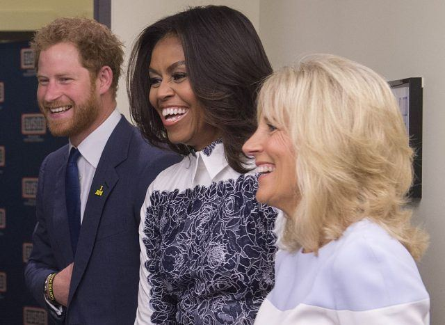 Britain's Prince Harry, US First Lady Michelle Obama and Jill Biden, wife of the US Vice President, tour the USO Warrior and Family Center at Fort Belvoir, Virginia