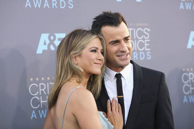 Jennifer Aniston and Justin Theroux pose on the red carpet.