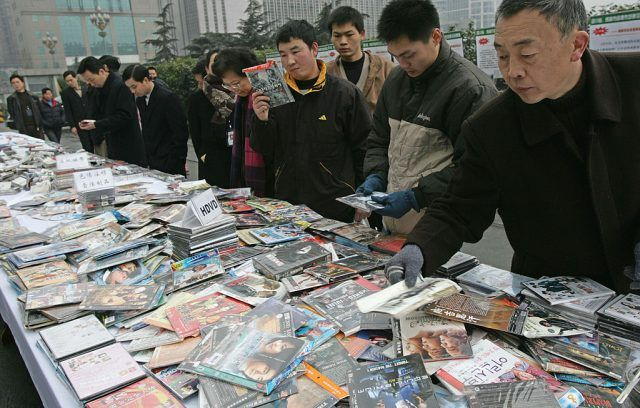Tourists browse DVDs in China