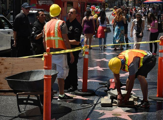 Crew from the Jimmy Kimmel Show prank passerby by pretending to dig up and remove the Donald Trump Star and replace it with one for Cesar Milan on the Hollywood Walk of Fame in Hollywood, California