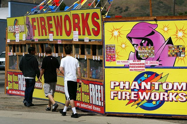 A fireworks stand, one of about 25 booths that are open for business, advertises on the first day of fireworks sales for Fourth of July celebrations