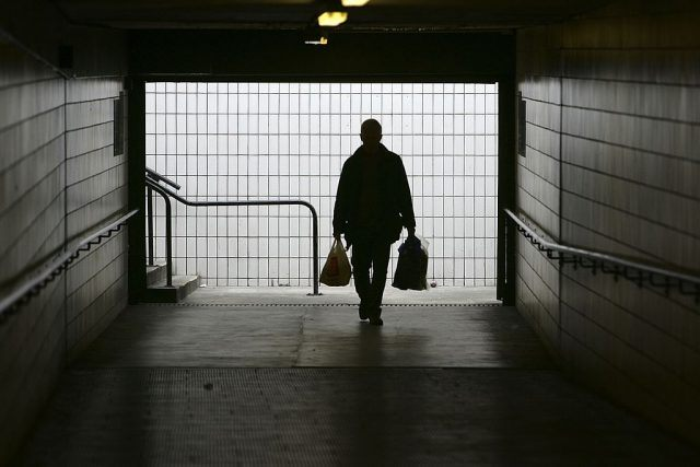 A man makes his way home at Preston bus station