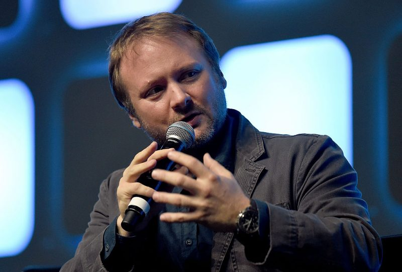 Rian Johnson speaks into a microphone at Star Wars Celebration